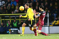 Burton Albion midfielder Marcus Harness (16) is tackled by Bradford City defender Anthony O'Connor (6) during the EFL Sky Bet League 1 match between Burton Albion and Bradford City at the Pirelli Stadium, Burton upon Trent, England on 26 January 2019.