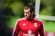 Gareth Bale of Wales looks on during the Wales football team training session at the Vale Resort, Hensol Castle near Cardiff ,South Wales on Monday 31st August  2015. The team are preparing for their next EURO 2016 qualifying match away to Cyprus later this week.<br /> pic by Andrew Orchard, Andrew Orchard sports photography.