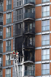 © Licensed to London News Pictures. 07/05/2021. London, UK. Fire fighters inspect the damage at New Providence Wharf on Fairmont Avenue in Poplar in east London. 100 fire fighters and 20 crews tackled the blast at it's peak.Photo credit: Peter Macdiarmid/LNP