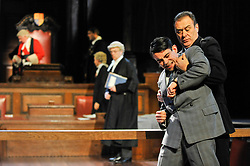 """© Licensed to London News Pictures. 20/10/2017. London, UK. Jack McMullen as Leonard Vole, the accused is restrained by John House as the Warder.  Photocall for """"Witness for the Prosecution"""", by Agatha Christie, directed by Lucy Bailey, at London County Hall.  The play opens 23 October. Photo credit : Stephen Chung/LNP"""