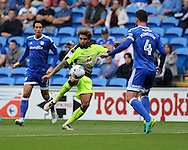 Danny Williams of Reading © controls the ball ahead of Sean Morrison of Cardiff city but shoots wide of goal.  EFL Skybet championship match, Cardiff city v Reading at the Cardiff city stadium in Cardiff, South Wales on Saturday 27th August 2016.<br /> pic by Andrew Orchard, Andrew Orchard sports photography.
