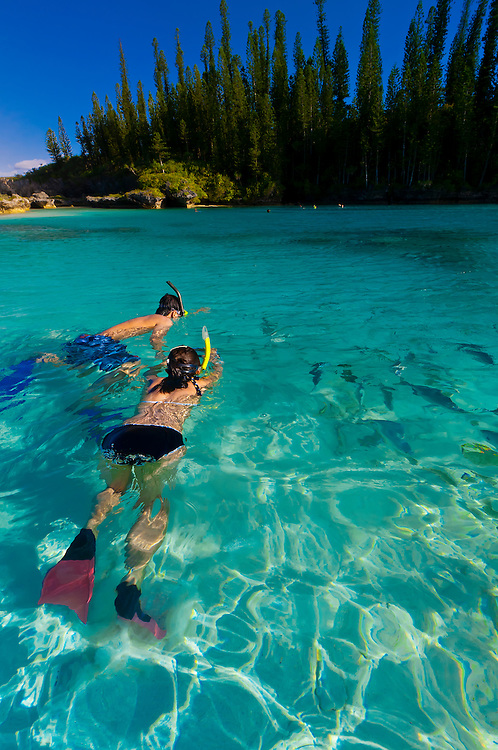 Snorkeling in the natural pool at Oro (swimming hole) on Isle of Pines (Ile des Pins), New Caledonia.