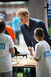 July 28, 2017 - London, London, United Kingdom - Image ©Licensed to i-Images Picture Agency. 28/07/2017. London, United Kingdom. Prince Harry visits Street Games. Central Park,East Ham. .Prince Harry  visits a summer holiday activity session run by Newham Council's leisure trust active Newham in Central Park, East Ham. The session, which forms part of the Fit and Fed campaign, aims to provide children and young people from the borough with free access to activity sessions, with lunch included, throughout the summer holidays.Picture by i-Images (Credit Image: © i-Images via ZUMA Press)