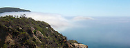 A sea of fog blankets the mountains of the Big Sur coast in California
