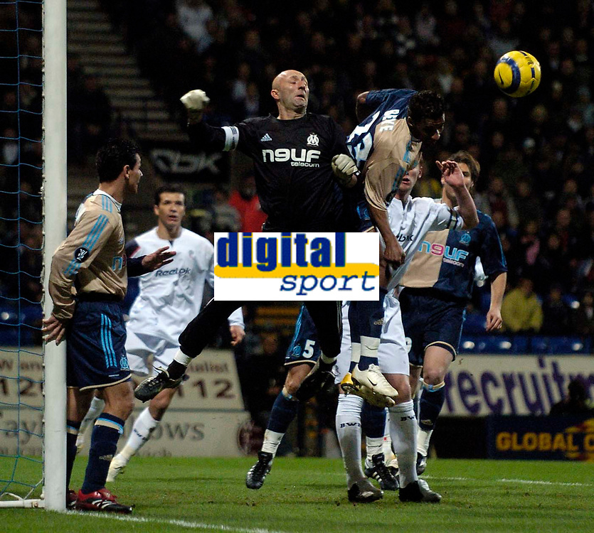 Photo: Jed Wee.<br /> Bolton Wanderers v Marseille. UEFA Cup. 15/02/2006.<br /> <br /> Marseille's flambuoyant goalkeeper Fabien Barthez (L), formerly of Manchester United, contests with team mate Habib Beye for the same ball.