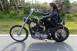 Kissa Von Adams riding her 1996 custom Harley-Davidson Sportster Chopper on a ride to Cape Canaveral during Daytona Beach Bike Week, FL. USA. Monday, March 11, 2019. Photography ©2019 Michael Lichter.