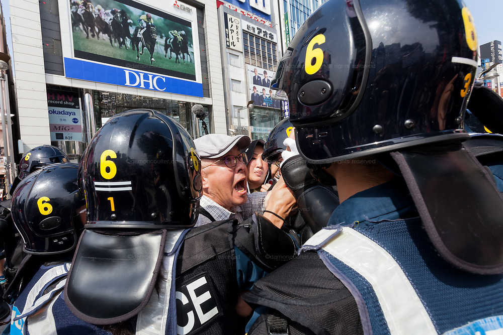 A right ¥winger tries to attack Left-wingers and activists against the Emperor system in Japan as they demonstrate against the visit of US President, Donald Trump to Japan and the Emperor system. Shinjuku, Tokyo, Japan. Sunday May 26th 2019. A small group of about 50 activists who object to the Japanese Imperial family system was met by a counter-protest of right-wingers and nationalists.