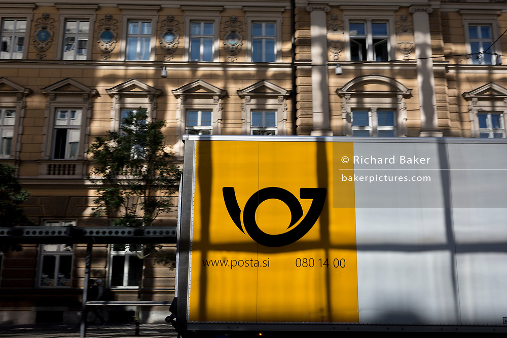 The logo for the Slovenian postal service (Posta Slovenije) on the side of a vehicle  outside the main post office on Slovenska Cesta (street) in the Slovenian capital, Ljubljana, on 25th June 2018, in Ljubljana, Slovenia.