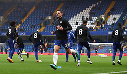 """Chelsea's Cesar Azpilicueta (centre) and his team-mates wearing the shirt number """"8"""" on their pre-match training shirts in memory of the late Ray Wilkins"""