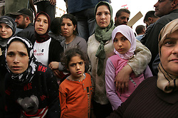 A group of women and children are seen during a pro-Syrian protest in Beirut, Lebanon, March 8, 2005. Hundreds of thousands of pro-Syrian protesters gather and chant anti-American slogans. Hezbollah, the militant Shiite Muslim group, called for a nationwide demonstration against foreign intervention and to counter weeks of massive anti-Syrian rallies.