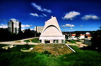 """Saint Peter is a concrete building in the commune of Firminy, France. The last major work of French Swiss-born architect Le Corbusier, it was completed in 2006, 41 years after his death.<br /> Designed to be a church in the model city of Firminy Vert, the construction of Saint-Pierre was begun in 1971, six years after Le Corbusier's death in 1965. Due to local political conflicts it remained stalled from 1975 to 2003, when the local government declared the mouldering concrete ruin an """"architectural heritage"""" and financed its completion. It has been used for many different purposes, as a secondary school and as a shelter. As the laicist French state may not use public funds for religious buildings, Saint-Pierre is now used as a cultural venue.<br /> The building was completed by French architect José Oubrerie, Le Corbusier's student for many years.<br /> <br /> L'église Saint-Pierre de Firminy est une église catholique située à Firminy dans la Loire en France.<br /> Cette église est un bâtiment en béton situé dans la commune de Firminy, c'est un des derniers projets de l'architecte Le Corbusier. Le Corbusier l'a conçu pour être une église dans la ville modèle de Firminy Vert, voulue en 1953 par l'ancien maire Eugène Claudius-Petit qui fut ministre de la Reconstruction et de l'urbanisme. La construction de Saint-Pierre a commencé en 1970, cinq ans après la mort de Le Corbusier. Elle a été achevée 41 ans après sa mort le 26 novembre 2006. Cependant, le bâtiment n'est pas officiellement une église ; il sert surtout à témoigner de l'oeuvre architecturale de Le Corbusier."""