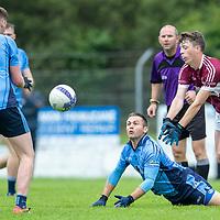 St. Joseph's Doora-Barefield's Conor Branock in action against Kildysart's John Ginnane and Luke McGrath