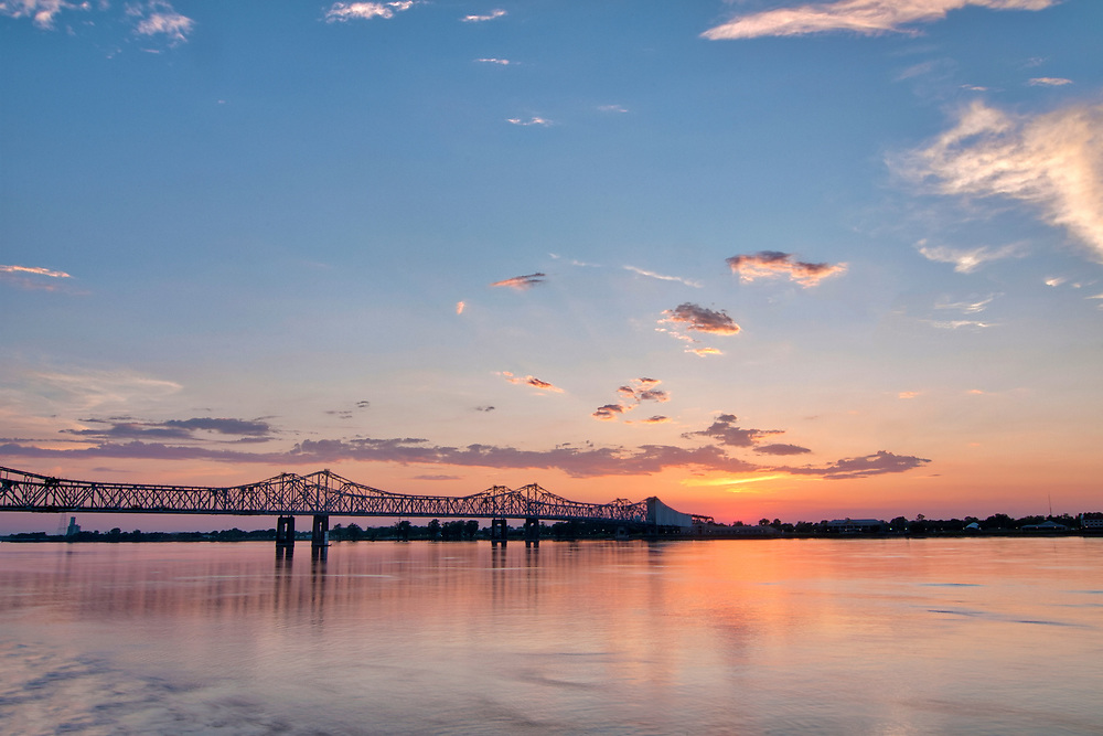 A warm sunset across the Mississippi River in Natchez, Mississippi on Wednesday, May 16, 2018. Copyright 2018 Jason Barnette