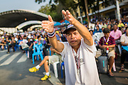 """29 DECEMBER 2013 - BANGKOK, THAILAND: An anti-government protestor near Democracy Monument in the old part of Bangkok to protest the ruling Pheu Thai party. Protest leader and former Deputy Prime Minister Suthep Thaugsuban announced an all-out drive to eradicate the """"Thaksin regime."""" The anti-government protesters have vowed to continue their protests even though the government has been dissolved and new elections called for in February. The protests have been ongoing in Bangkok since November and are growing increasingly violent.             PHOTO BY JACK KURTZ"""