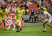 Australia's Liam McNamara makes a break during the HSBC World Rugby Sevens Series - Singapore, Bronze match Australia-V-England at The National Stadium, Singapore on Sunday, April 16, 2017. (Steve Flynn/Image of Sport)