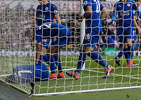 Football - 2016 / 2017 Premier League - Tottenham Hotspur vs. Leicester City<br /> <br /> Worried Leicester players run in to check on goalscorer Ahmed Musa of Leicester City after he does not move after scoring at White Hart Lane.<br /> <br /> COLORSPORT/DANIEL BEARHAM