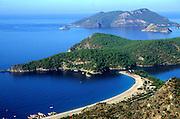 Raised view of beach and lagoon, Olu Deniz, Fethiye, Turkey