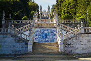 Tourist visits 18th Century hilltop chapel Nossa Senhiora Dos Remedios with 686 steps on stairways and azulejos tiles in Lamego, Portugal.