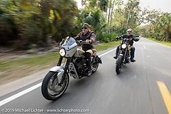 Andrea Labarbara (L) on her Roland Sands RSD custom with her husband Bob Zeolla riding his custom Harley-Davidson on a ride through Tomoka State Park during Daytona Beach Bike Week, FL. USA. Friday, March 15, 2019. Photography ©2019 Michael Lichter.