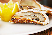 Bouzigues Languedoc. Oyster on half shell with lemon. France. Europe.