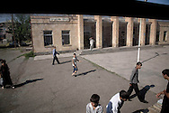 Passengers at the train station in Araks.<br /> The town was founded as a state farm in 1940. Nearby was the Battle of Sardarapat (May 1918) on whose site is erected the Sardarapat Monument.Local residents travel on train to Gyumri with the fruits they whole sale there.
