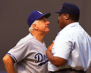 QUEENS, NY - 1989: Manager Tommy Lasorda of the Los Angeles Dodgers argues with umpire Eric Gregg during an MLB game versus the New York Mets at Shea Stadium in Queens, NY during the 1989 season. (Photo by Ron Vesely) Subject:   Tommy Lasorda; Eric Gregg