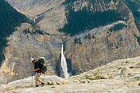 Hikers on the Iceline Trail, Takakkaw Falls in the distance, Yoho National Park British Columbia Canada