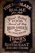 Pub sign advertising Real ale, beer garden food and atmosphere, at the Mudlark near London Bridge.
