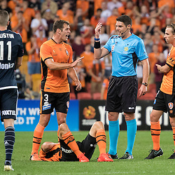 BRISBANE, AUSTRALIA - OCTOBER 7: Luke DeVere and Brett Holman of the Roar argue with referee Shaun Evans during the round 1 Hyundai A-League match between the Brisbane Roar and Melbourne Victory at Suncorp Stadium on October 7, 2016 in Brisbane, Australia. (Photo by Patrick Kearney/Brisbane Roar)