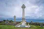 Grave and celtic cross monument to commemorate Flora MacDonald, Scottish patriot and hero in graveyard at Kilmuir, Isle of Skye, the Western Isles of Scotland, UK