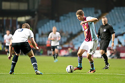Aston Villa's Nicklas Helenius takes on Tottenham Hotspurs' Jan Vertonghen  - Photo mandatory by-line: Nigel Pitts-Drake/JMP - Tel: Mobile: 07966 386802 24/09/2013 - SPORT - FOOTBALL -  Villa Park - Birmingham - Aston Villa v Tottenham Hotspur - Round 3 - Capital One Cup