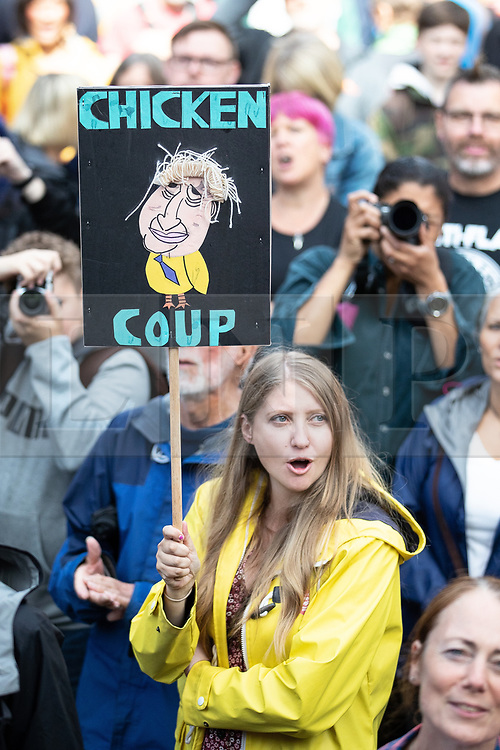 """© Licensed to London News Pictures. 31/08/2019. Manchester, UK. A placard reading """" Chicken Coup """" . Thousands attend a pro EU demo in Albert Square in Manchester City Centre , with objections raised to the Prime Minister Boris Johnson's intention to prorogue Parliament in the run up to Britain's planned Brexit deadline . Photo credit: Joel Goodman/LNP"""