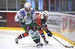Bostjan Groznik of Olimpija vs Marcel Rodman of Jesenice at 2nd final match of Slovenian National Championships  between HK Acroni Jesenice and HDD Tilia Olimpija, on March 17, 2009, in Podmezaklja, Jesenice, Slovenia. Acroni Jesenice won after free shots 2:1 and are leading 2:0. They need to win 2-times more. (Photo by Vid Ponikvar / Sportida)