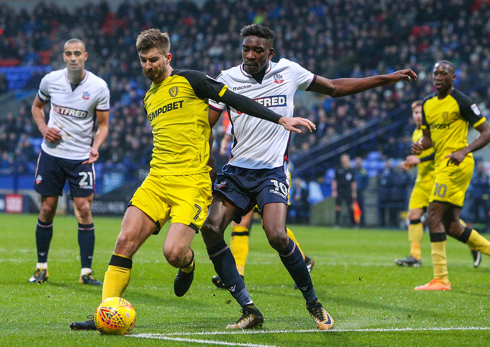Bolton Wanderers' Sammy Ameobi vies for possession with Burton Albion's Luke Murphy<br /> <br /> Photographer Alex Dodd/CameraSport<br /> <br /> The EFL Sky Bet Championship - Bolton Wanderers v Burton Albion - Saturday 16th December 2017 - Macron Stadium - Bolton<br /> <br /> World Copyright © 2017 CameraSport. All rights reserved. 43 Linden Ave. Countesthorpe. Leicester. England. LE8 5PG - Tel: +44 (0) 116 277 4147 - admin@camerasport.com - www.camerasport.com
