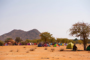 Himba tents and campsite at a funeral gathering, Kaokoland, Namibia