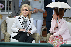 Left to right, HRH PRINCESS MICHAEL OF KENT and LADY ELIZABETH ANSON at Goffs London Sale held at The Orangery, Kensington Palace, London on 15th June 2015.