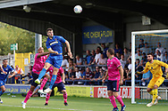 AFC Wimbledon defender Jon Meades (3) with a header on goal during the Pre-Season Friendly match between AFC Wimbledon and Queens Park Rangers at the Cherry Red Records Stadium, Kingston, England on 14 July 2018. Picture by Matthew Redman.