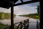 Landscape with view from wooden jetty on the bank of San Juan River, Nicaragua