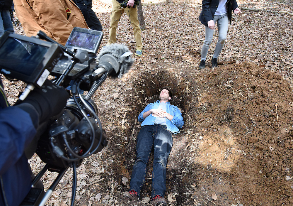 """April 5, 2016, Guilford, CT<br /> Mara Lavitt -- Special to the Hartford Courant<br /> Guilford native Matt Newton of Greenwich on his family's property in Guilford making his horror short-film """"Hide/Seek."""" Director of photography Kristian Borysevicz of NYC frames a shot with actor Bryan Manley Davis of Brooklyn, NY in a shallow grave."""