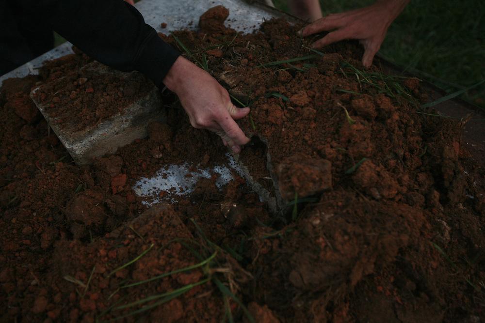 Pittsboro, NC - May 12: Noel and Grey work at making bio-char at  the farm at Circle Acres. (Photo by Logan Mock-Bunting)