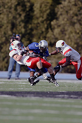 25 November 2006: Tom Nelson pulls Jermaine Mobley to the turf. The Redbirds romped the Panthers by a score of 24-13.&#xD;This game was a 1st round NCAA Division 1 Playoff held at O'Brien Stadium on the campus of Eastern Illinois University in Charleston Illinois.<br />