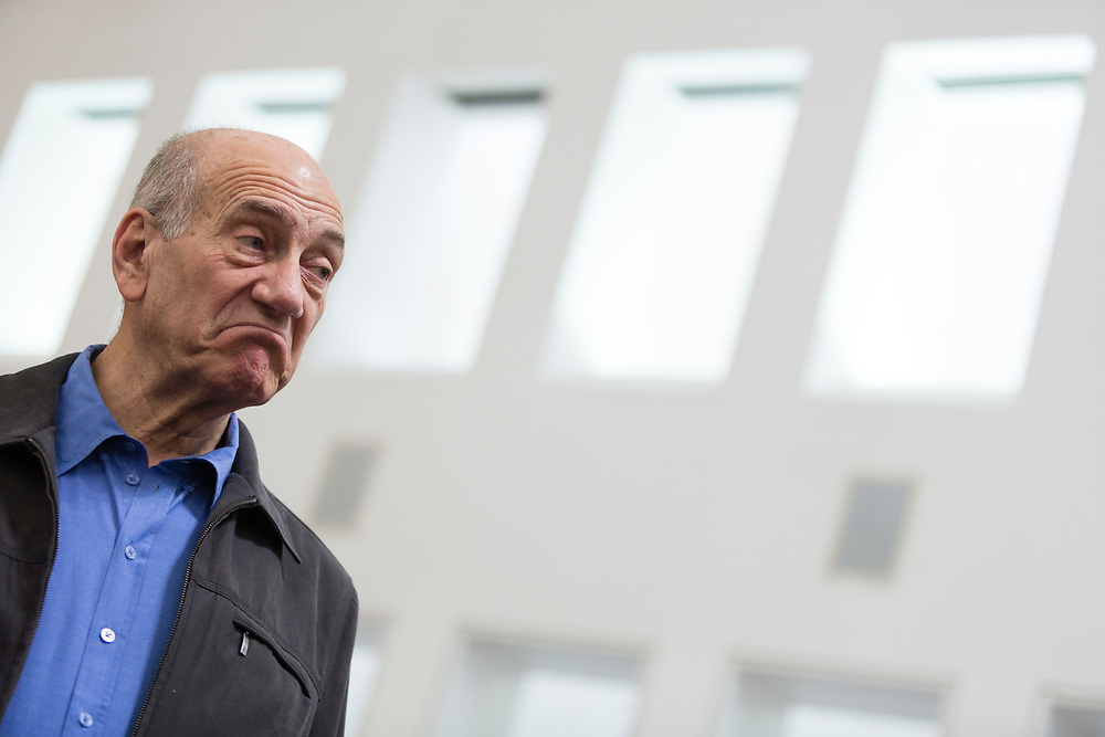 Former Israeli Prime Minister Ehud Olmert is seen at the courtroom of the Supreme Court in Jerusalem, Israel, on December 04, 2014. An expanded five-justice panel of the Supreme Court heard the third day of appeals by former PM Ehud Olmert to overturn a district court decision from last year, that found him guilty of bribery over his ties to to the construction of the massive Holyland residential complex when he served as the mayor of Jerusalem, in one of the worst corruption scandals in Israeli history.