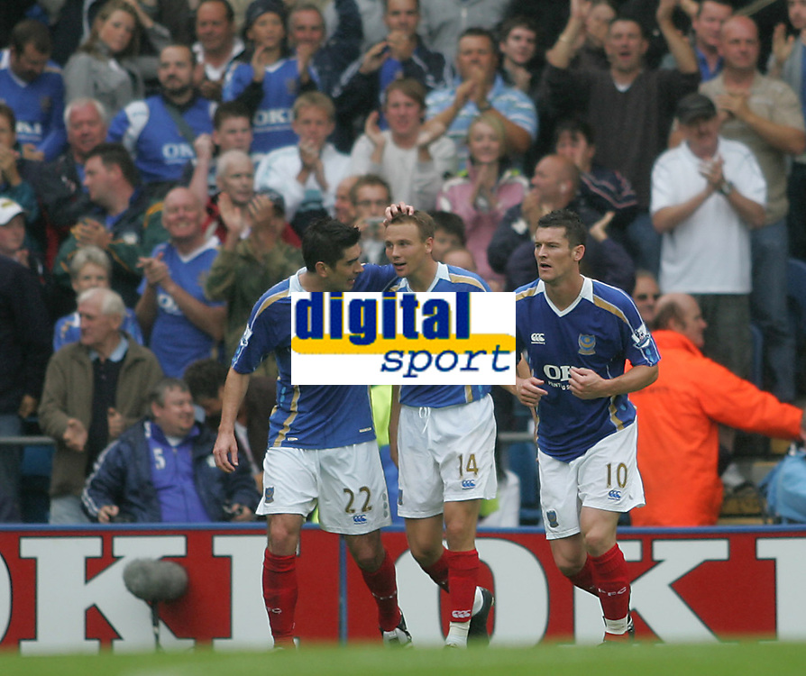 Photo: Lee Earle.<br /> Portsmouth v Bolton Wanderers. The FA Barclays Premiership. 18/08/2007.Portsmouth's Matthew Taylor (C) is congratulated by Richard Hughes (L) and David Nugent after he scored their third goal.