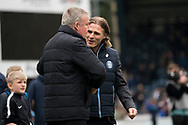 Wycombe Wanderers manager Gareth Ainsworth greets Portsmouth manager Kenny Jackett during the EFL Sky Bet League 1 match between Wycombe Wanderers and Portsmouth at Adams Park, High Wycombe, England on 6 April 2019.