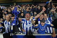 Brighton and Hove Albion fans and supporters celebrate victory at the final whistle of the EFL Sky Bet Championship match between Queens Park Rangers and Brighton and Hove Albion at the Loftus Road Stadium, London, England on 7 April 2017.
