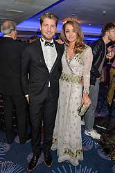 STEVIE JOHNSON and CRESSIDA STEWART at the Chain of Hope Ball held in aid of the charity Chain of Hope, founded by Professor Sir Magdi Yacoub which organises volunteer teams worldwide to operate on children suffering from life-threatening heart diseases, held at the Grosvenor House Hotel, Park Lane, London on 20th November 2015.