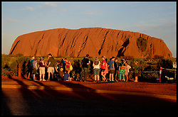 General Views of tourist taking pictures at sunset at Ayers Rock/Uluru, Australia. Monday, 21st April 2014. Uluru, also known as Ayers Rock and officially gazetted as Uluru / Ayers Rock, is a large sandstone rock formation in the southern part of the Northern Territory in central Australia. Picture by Andrew Parsons / i-Images