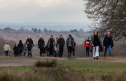 © Licensed to London News Pictures. 02/01/2021. London, UK. Families and walkers enjoy a stroll in the sunshine in tier 4 restrictions on the first Saturday of 2021 in Richmond Park, South West London as weather forecasters predict a milder week ahead with rain. Last Wednesday the Oxford vaccine was approved for use, with the government securing over 100 million doses with an expected full rollout of vaccinations from this Monday, January 4th 2021 as the coronavirus pandemic crisis continues into the new year. UK. Photo credit: Alex Lentati/LNP