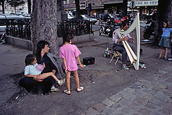 Family Listening to Man pLaying The Harp
