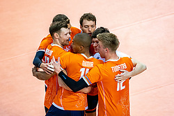 Michael Parkinson of Netherlands, Nimir Abdelaziz of Netherlands, Bennie Tuinstra of Netherlands, Wessel Keemink of Netherlands celebrate during the CEV Eurovolley 2021 Qualifiers between Sweden and Netherlands at Topsporthall Omnisport on May 14, 2021 in Apeldoorn, Netherlands